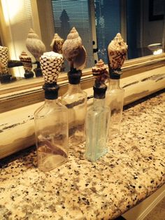 Vintage Shell Bottles  Beach Chic Antique bottle by PierAvenue - Coolest Bottles ever!  So Stoked to buy these and put them up in my beach apartment!!! Thank you Mike!!