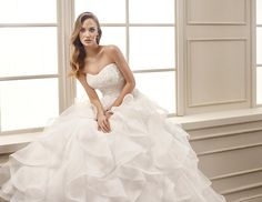 Eddy K. style - EK1067: Sleeveless, sweetheart neckline, ball gown, organza and embroidered lace with Venice beaded appliques wedding dress. Available in Ivory