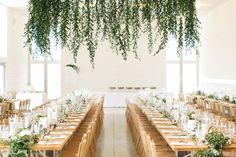 hanging greenery chandelier - plain hula-hoops with garland hanging like this, with battery operated twinkle lights, hanging above each table?