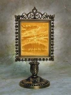 Sunrise Lithophane Victorian Stand Antique Brass by Porcelain Garden. $47.50. First invented in France in 1827, a Lithophane is a porcelain engraving that virtually comes alive when illuminated from behind! A panel of different thickness of translucent, kiln-fired porcelain creates the image. A breathtakingly detailed picture in warm sepia tones emerges when lit. These illuminated artworks are so detailed, that they will amaze you for years to come.They are complete with a...