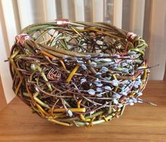 A new random willow basket with copper wire and some catkins.