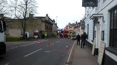 Car on fire in Bridge St Witney causing massive delays.