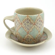 Teacup and Saucer - Ceramic Mug - Cup - with Salmon, Purple and Turquoise Pattern. $42.00, via Etsy.