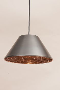 Rivet Suspension in oxidized brass and copper designed by David Irwin