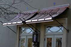 copper awnings over double doors