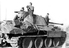 A Panther Ausf D sitting idle with a crew member keeping an eye on out for enemy fighter bomber threats