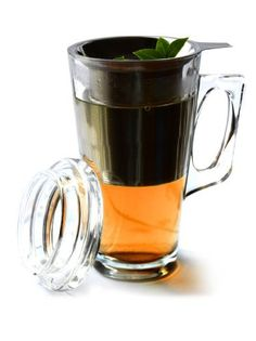 AdNArt Tea Mug with Stainless Steel Infuser by AdNArt. $18.69. 12-Ounce capacity. Removable stainless-steel infuser. Dishwasher and microwavable safe. Lid turns into trivet to hold infuser. Works with loose leaf, tea bags and coarse ground coffee. Artistic and graceful, the Tea Party Mug Set is like a teapot in a cup. It has a large infuser basket that holds the tea leaves and a glass lid that keeps the tea warm while it steeps. It is very easy to use: place the infuser bask...