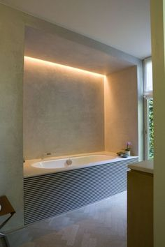 Lovely bathroom lighting using LED strip lights to create an ambient light when relaxing in the bath. No more bright spot lights shining directly into eyes!!