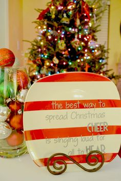 DIY Christmas Plate. You could do it his way or use a Sharpie and bake dry to save youself all the messy paint and hours cutting letters out! ^_^