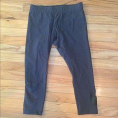 Nike grey Capri workout pants Great condition worn only a couple of times! Grey with black accent Nike logo on the bottom left leg. Open to offers! Nike Pants Capris