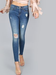 """The Mid-Rise Skinny Jeans are classic jean. Features distressed details, a rich blue hue and a mid-rise fit. Measures 38.25"""" in. approx. from waist to bottom hem. Complete the look with ankle booties and a mock neck top. Modeled in a size 3. #denim #MakeMeChic #style #fashion #newarrivals"""