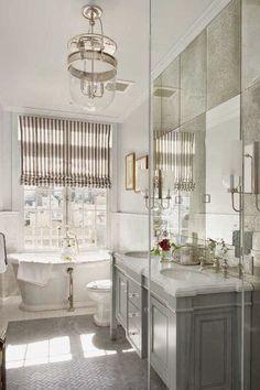 pretty bathroom with antiqued mirror