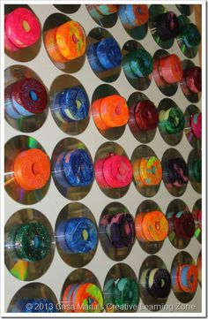 Cut up Styrofoam pool noodles into equally sized pieces. Dip them into marbled paint. Display!