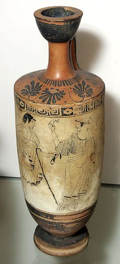 Pottery lekythos (oil bottle) with Athena holding a helmet and shield.