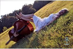graduate! (i like this idea for my senior pictures, but with my cello.)