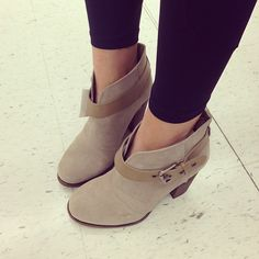 love booties- buckle definitely completes it. i like the taupe color paired with the black leggings.