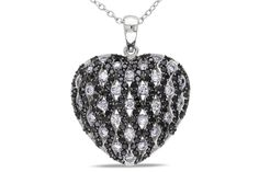 This elegant heart pendant features round-cut black and white cubic zirconia stones set in sterling silver. This pendant is hung on an 18 inch silver cable chain and is secured with a spring ring clasp.