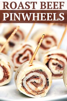 A Quick and Easy Recipe For Parties Garlic Roast Beef Pinwheels By Life Tastes Good Make A Tasty Appetizer In About Minutes These Pinwheels Can Be Made Up Ahead Of Time Too It Doesn't Get Much Better Than That For Quick And Easy Party Food Meat Appetizers, Appetizer Recipes, Snack Recipes, Pinwheel Appetizers, Fudge Recipes, Pudding Recipes, Yummy Recipes, Dessert Recipes, Dinner Recipes