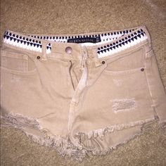 Tan shorts I got these from PacSun. They are a size 25, and they don't fit me, so I have never worn them. The brand on the shorts says PS Erin Wasson PacSun Shorts