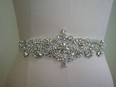 Wedding Belt, Bridal Belt, Sash Belt, Crystal Rhinestone Sash- Style B70018 Absolutely Dazzling Finest Crystal Rhinestone& Pearl belt will take your breath away! ** Total Length X Width of rhinestone part = about 9 1/4 inches X 2 3/4 inches at the widest points. ** Total sash