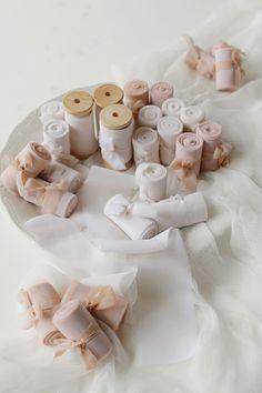 Neutral silk ribbons on wooden spool #neutralsilkribbons #neutralwedding #taupewedding #ivorywedding #fineartwedding