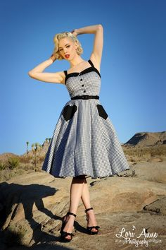 Pinup Couture Betsey Swing Dress in Black Gingham - Why wear your heart on your sleeve when you can have two on your skirt?  And they're pockets!  With its more modest neckline, faux buttons, adjustable straps, removable accent belt, and full circle skirt, the Betsey is the quintessential rockabilly dress.  And because it's made of a heavy, high-quality cotton stretch sateen, you'll be a complete sweetheart in it for years to come!