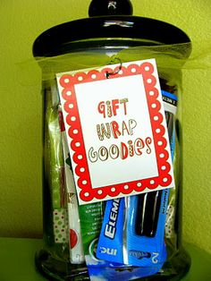 This could be a really cute and useful gift...homemade gift tags, scissors, tape and a good pen...hmmm