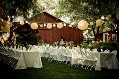 not crazy about the plastic chairs, but i love the lights and lanterns strung overhead
