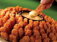 {Outback's Bloomin' Onion Sauce}... 1 pint mayo, 1 pint sour cream, 1/2 c chili sauce, 1/2 t cayenne..... ***Bloomin' Onion recipe included in link***