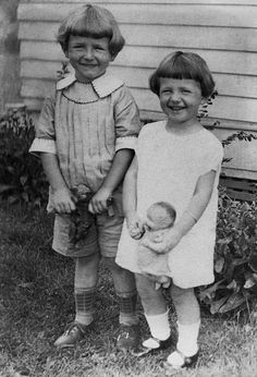 Siblings with Teddy Bear and Doll
