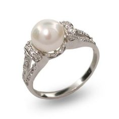 Pearl ring. I think I may not want a traditional wedding ring. But I probably don't want a pearl ring as an engagement ring.