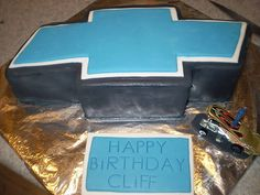 Chevrolet Cake for grooms cake? Except the lining would be gold & the center black