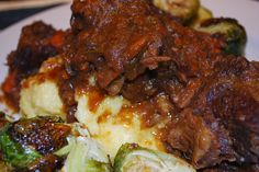 Port Wine Braised Short Ribs with Creamy Cheddar Polenta | from Go Ahead... Take A Bite! #ChristmasEve #Dinner #BraisedShortRibs #PortWine #RoastedBrusselsSprouts