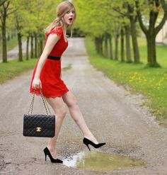 Jumping in Puddles  (by Sydney Hoffman) Red and black: one of my favorite color combos! This is why Chanel's little black bag is such a classic. It makes any outfit look put together.