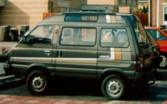 Subaru E12 4WD - 5 drs - kleur/grijs metalic - versnelling/half automaat - kenteken DD-JJ-90