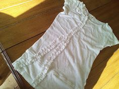 My sewing tutorial on how to remake plain old shirts into this cute ruffly tee.