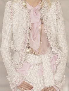 Pink tweed fringed, belted jacket and skirt with pink silk bow blouse | Chanel Spring 2004
