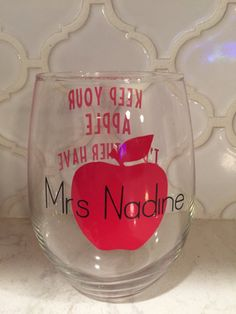 This makes a great gift for a teach for Christmas, end of year gift, or just because.  This can always be personalized with different colors. Just put the name and what you want in the comments at check out. Font on the front of the glass is shown in red and the teachers name is shown in black.  It is made from high quality vinyl. This is hand wash only