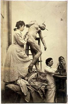 Camille Claudel working in Rodin's atelier.