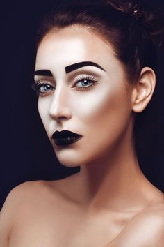 thick black eyebrows & black lipstick