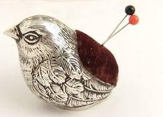 cute antique silver pin cushion.
