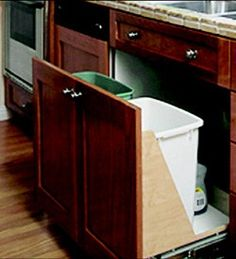 Storage for garbage and recycling bins under the sink.