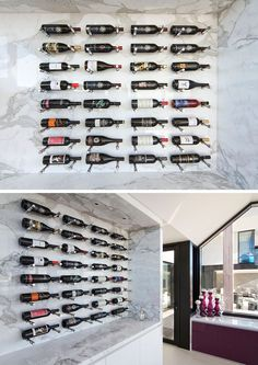 Wine Rack Ideas - Show Off Your Bottles With A Wall Mounted Display | The colorful labels and different shapes of the bottles stand out against the white marble of this display wall.