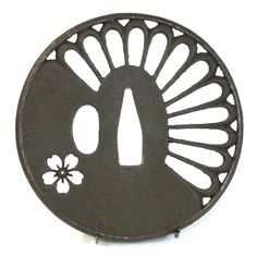 Iron marugata tsuba with chrysanthemum petals and cherry blossom flower, Japan, middle Edo