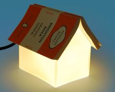 A frosted glass house shaped bedside reading lamp, that doubles up as a place to park your book and keep your page marked. Designed by Sang Jin Lee for Suck UK it is available from Emmohome.