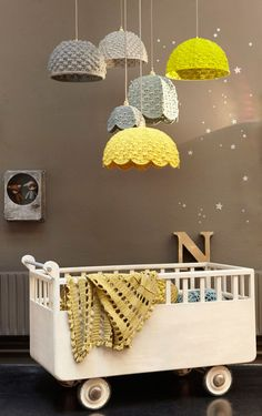 I saw this as a DIY project, but there's no way I'd know how to make this. Still...crochet + lampshade/mobile thing = cool.