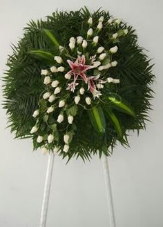 Like all the greenery on this Funeral Arrangement.