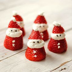 Want to make a (somewhat) healthy Christmas treat? Grab some strawberries and whip cream and make these mini Santas!-Jack's party treat