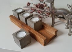 Jeder Teelichthalter wird aus Beton gegossen und in liebevolle Handarbeit angefe. Each tealight holder is poured from concrete and lovingly handcrafted. The concrete lights stand loosely in a solid Rustic Candles, Rustic Candle Holders, Lantern Candle Holders, Tea Light Candles, Candle Stand, Tea Lights, Wood Concrete, Concrete Light, Concrete Crafts