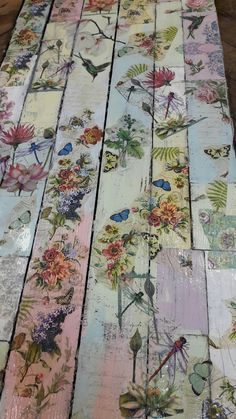 Wooden floor painted with chalk paints and decoupaged with napkins.